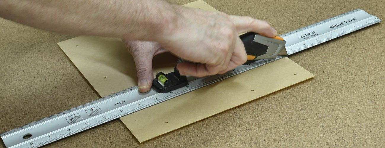Scoring a cut line on acrylic with a utility knife