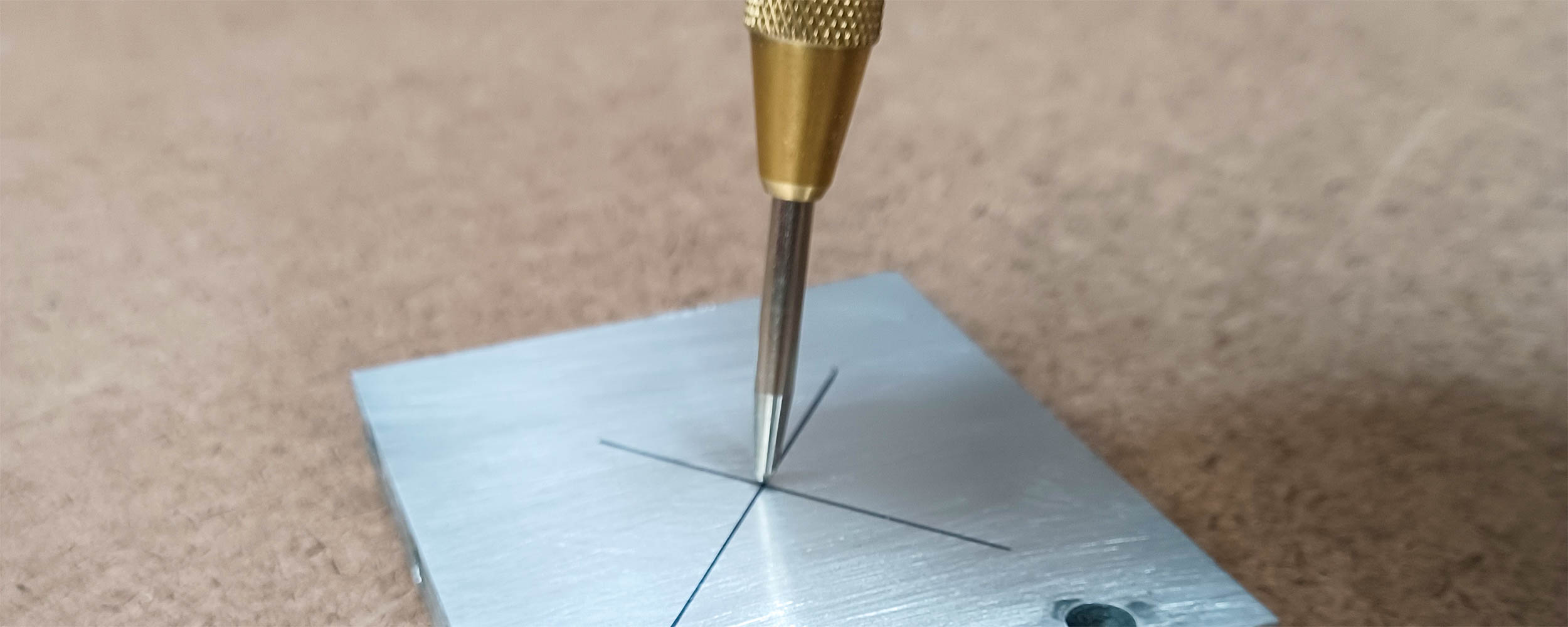 A center punch is perfect for marking metal
